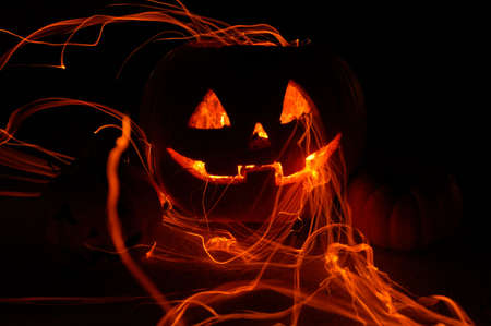 Set of three Halloween pumpkins surounded by fire