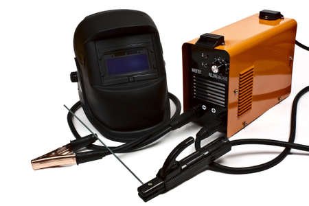 Inverter welding machine and mask on a white background photo
