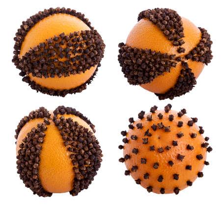 Christmas pomander of orange and clove isolated on white background