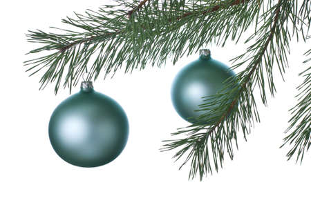 Branch with Christmas-tree decorations on a white background Stock Photo