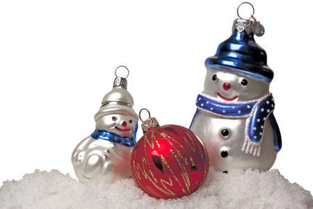 Two snowmen and red Christmas ball in the snow on a white background Stock Photo