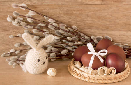 Easter eggs, rabbit and  catkins on a wooden background