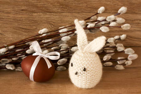 catkins: Easter egg, rabbit and  catkins on a wooden background