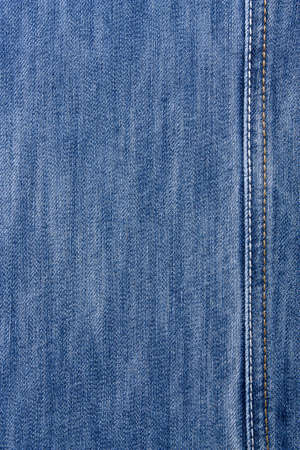 Blue jeans with yellow and white stitching