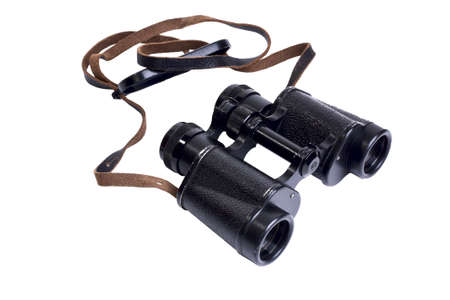 Old antique military binoculars isolated on white background