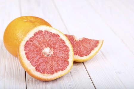grapefruit on a light wooden background. selective focus