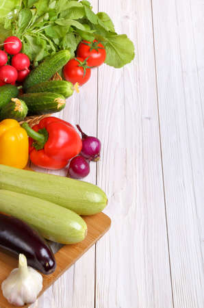 Set of vegetables on a light wooden background background Stock Photo - 19403620