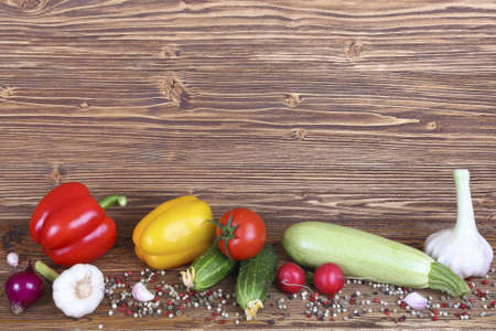 set of vegetables and place for text on wooden background
