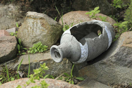 broken pitcher of ornamental stones
