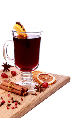 glass of mulled wine and ingredients on a wooden table isolated on white background Stock Photo - 21703292