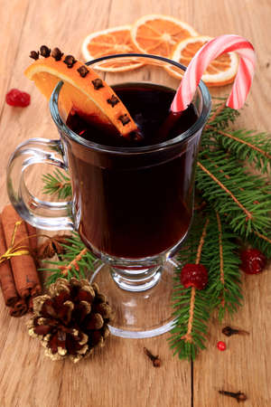 Christmas mulled wine with attributes on a wooden table Stock Photo - 21703294
