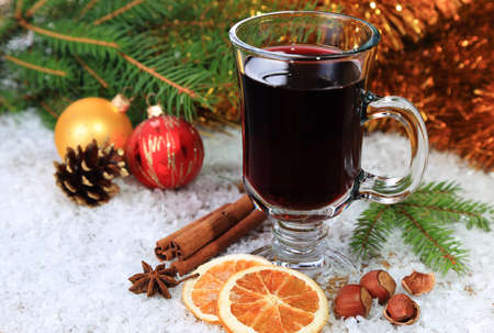 Mulled wine in a transparent glass in the snow Stock Photo - 21959720
