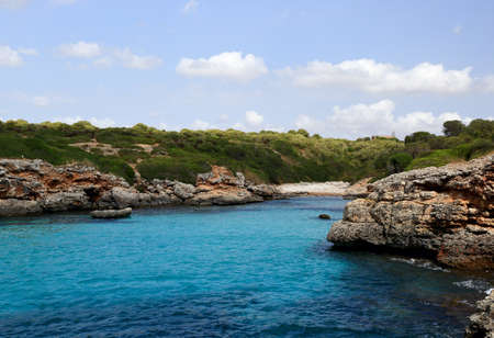 The beach in a quiet bay, the view from the sea. Mallorca. Spain photo