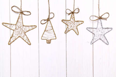 Handmade Christmas ornaments on a light wooden background