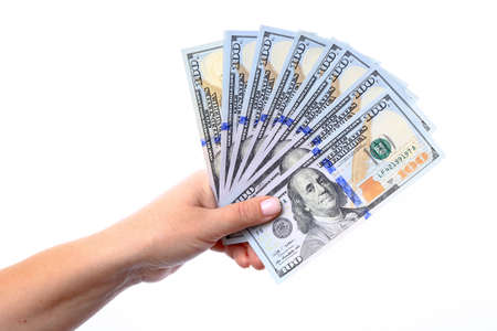 Hand holding a new hundred dollar bills U S  folded like a fan, released into the circulation in October 2013
