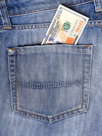 New U.S. hundred dollar bills put into circulation in October 2013 in the back pocket of jeans