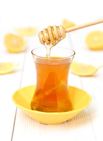 Tea with honey and lemon on a light wooden    Stock Photo
