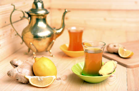 Turkish tea with ginger and lemon on wooden  Stock Photo - 24683762