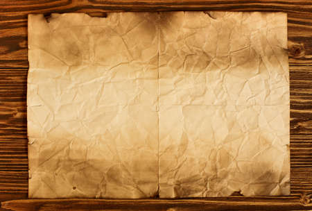 tex: Old paper on brown wooden background, place for tex Stock Photo