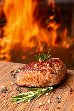 Grilled beef steak on a background of fire  selective focus
