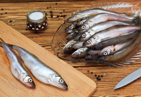 Crude shallow saltwater fish - smelt, on the kitchen table
