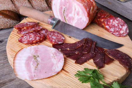 longaniza: Sliced cold meats on a cutting board, top view
