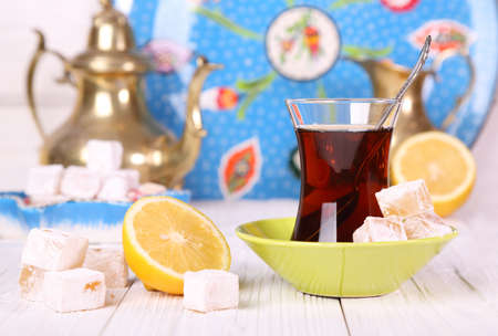 Tea with Turkish Delight and lemon on a white table Stock Photo