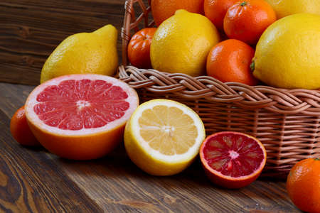orange peel clove: Citrus fruits - oranges, lemons, tangerines, grapefruit on a wooden table Stock Photo