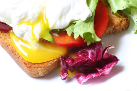 Poached egg with toast and salad, close-up, selective focus Stock Photo