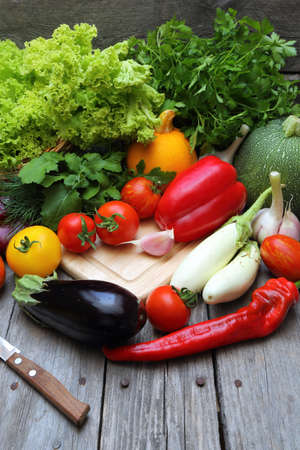 Set of fresh vegetables on a wooden table