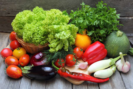 obody: Set of fresh vegetables on a wooden table