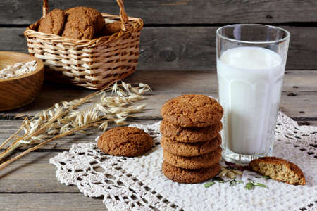 oatmeal cookie: Oatmeal cookies and milk on a wooden table
