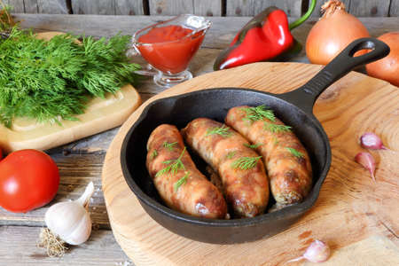 lunch tray: Grilled meat sausages in a pan on the table Stock Photo