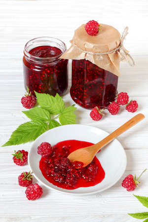 Raspberry jam on a white wooden table Stock Photo