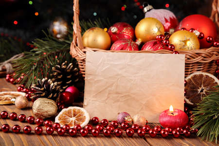 Holiday greeting card with Christmas decorations and candles and place for text