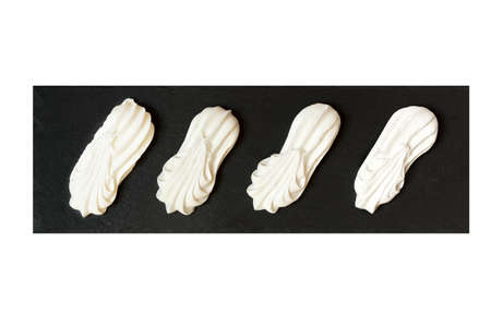 kiss biscuits: Meringues on a black tray isolated on white background Stock Photo