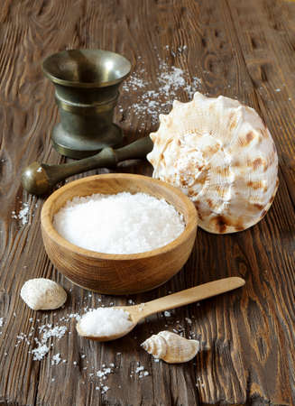 Sea salt in a wooden bowl on the table
