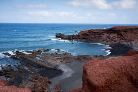 Beach of black volcanic sand on the coast of the island of Lanzarote, Canary Islands, Spain