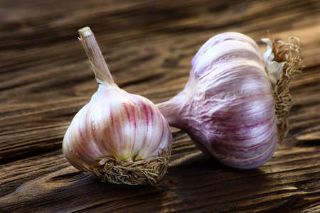 garlic closeup on wooden kitchen table Stock Photo