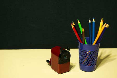 exemplar: Pencils and sharpener light table dark background