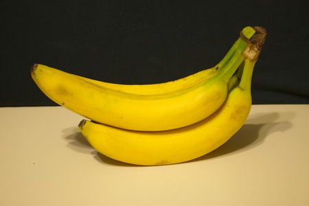 Bunch of bananas light table dark background