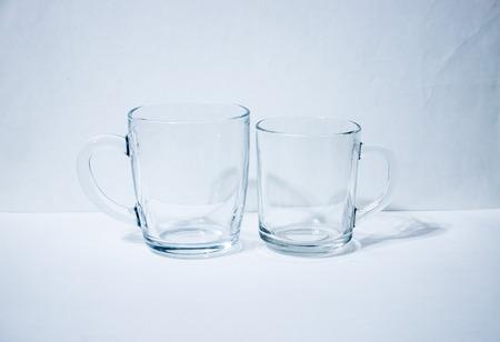Pair of glass beakers light background