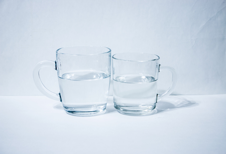 Two glasses of water light background