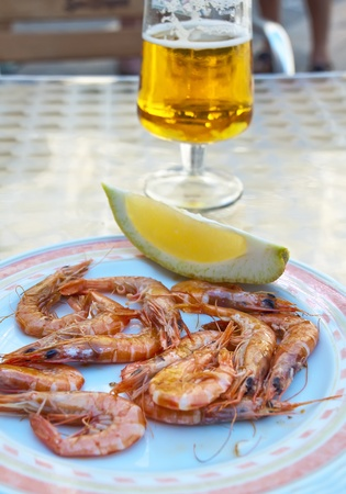 shrimp and beer, typical Spanish cover Stock Photo - 11359795