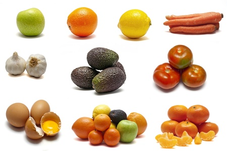 Fruits, vegetables and eggs on a white background
