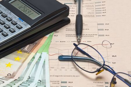 Money,Newspaper , glasses and Calculator