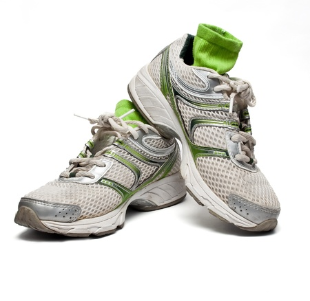 Used running shoes with socks Stock Photo
