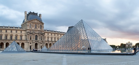 PARIS, FRANCE-SEPTEMBER 9: famous glass pyramid in the square of the Louvre Museum on September 9, 2010 in Paris, France. It was designed by architect Ieoh Ming Pei and inaugurated in 1989