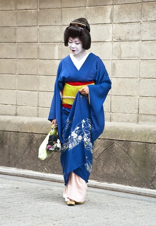 KYOTO, JAPAN, JULY 16: Unidentified geisha posing for photos in the Gion district on July 16, 2011 in Kyoto, Japan. In the 1920 had some 80,000 geisha in Japan, but today there are approximately 1,000. Stock Photo - 11389862