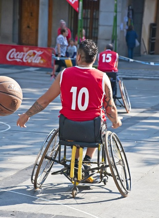 disabled sports: TOLEDO, SPAIN, OCTOBER 1: Some unidentified people playing a friendly game of wheelchair basketball